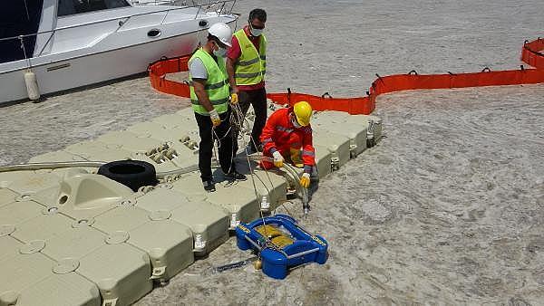 2021/06/canakkalede-ilk-gun-denizden-17-ton-musilaj-cekildi-05456895a388-14.jpg