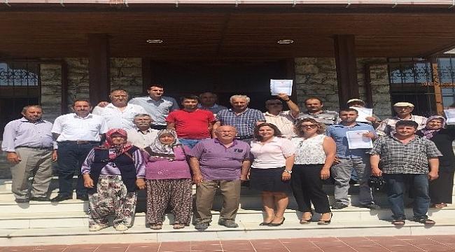 Turan'dan Gökçeadalılara tapu müjdesi