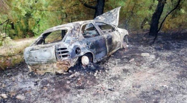 Virajı alamayarak ormana uçan otomobil alev aldı